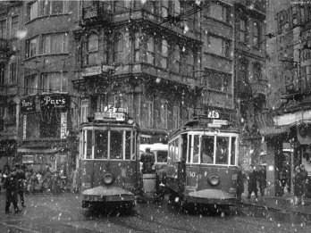 trams at galatasaray square on a snowy day, beyoglu, istanbul, 1960
