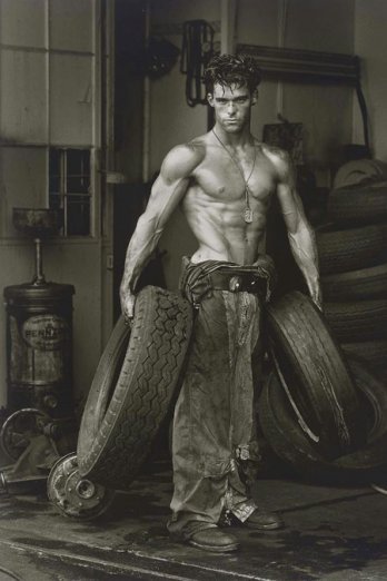 HERB RITTS_Fred with Tires, Hollywood, 1984